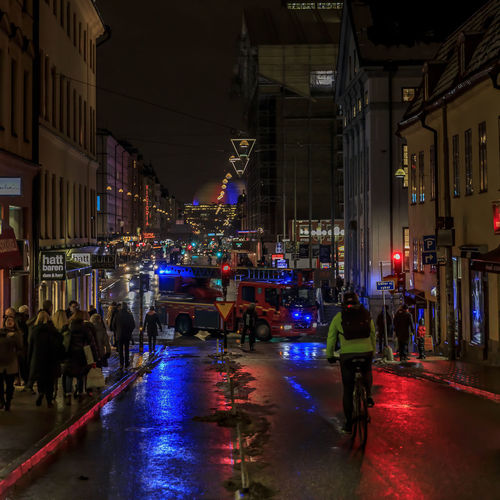 An accident has occurred and fire fighters are on their way Architecture Illuminated City Night Building Exterior Group Of People Built Structure Street Real People Transportation City Life Mode Of Transportation Large Group Of People Men Crowd Women City Street Road Outdoors Nightlife Stockholm Fire Fighters Winter Emergency Cyclist