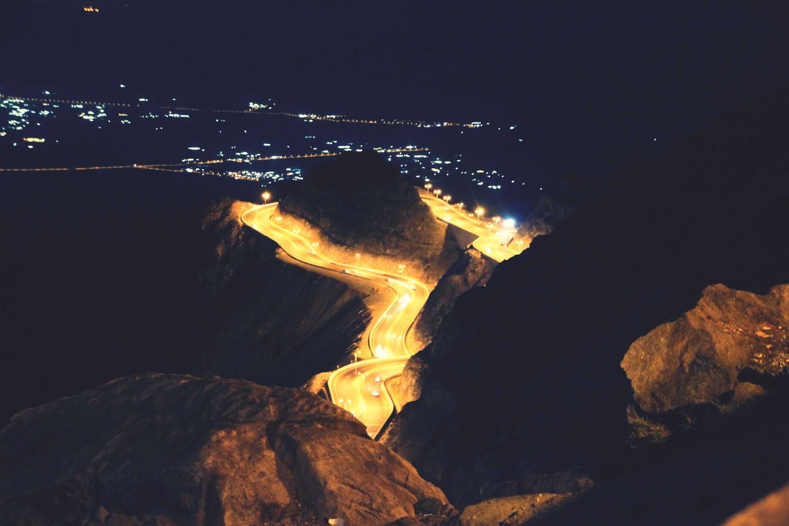 night, illuminated, high angle view, cityscape, city, mountain, built structure, building exterior, architecture, aerial view, landscape, copy space, dark, clear sky, outdoors, scenics, no people, nature, sky, mountain range