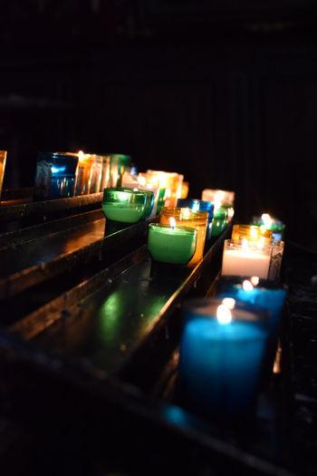 Illuminated tea lights candles in church