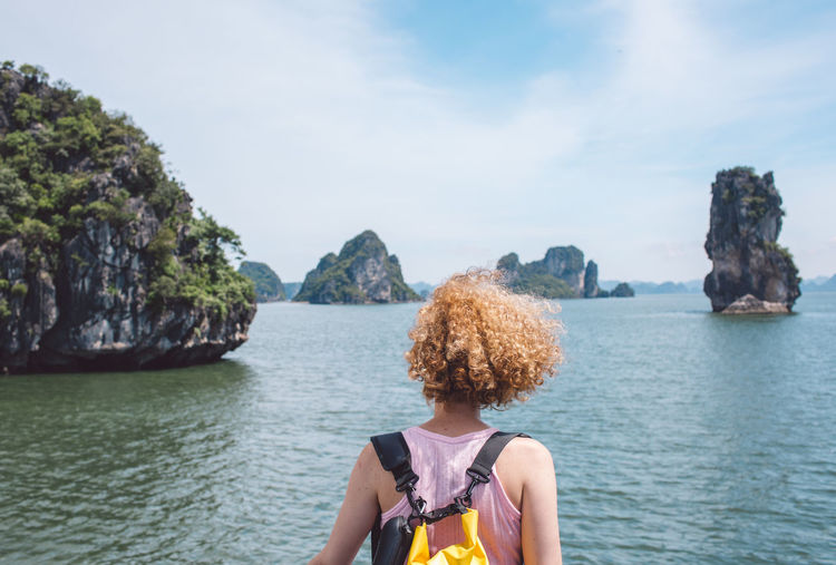 Beauty In Nature Curly Hair Day Girl Hair Hairstyle Leisure Activity Lifestyles Nature One Person Outdoors Real People Rear View Rock Rock - Object Scenics - Nature Sea Sky Solid Water Women Young Adult A New Perspective On Life