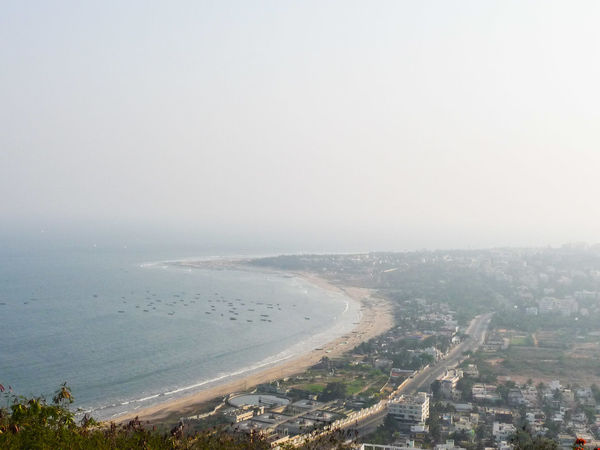 VISAKHAPATNAM SEA SHORE SEEN FROM KAILASAGIRI HILL City Cityscape Water Fog Sea Skyscraper Beach Urban Skyline Aerial View Beauty Scenics Calm Tranquil Scene Tranquility