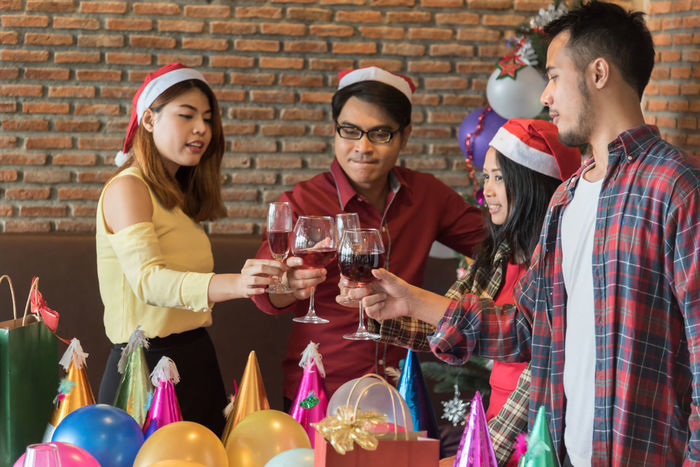 Alcohol Candle Celebration Day Drink Drinking Enjoyment Food And Drink Friendship Indoors  Lifestyles Men Party - Social Event Real People Red Wine Smiling Standing Table Togetherness Wine Wineglass Women Young Adult Young Men Young Women