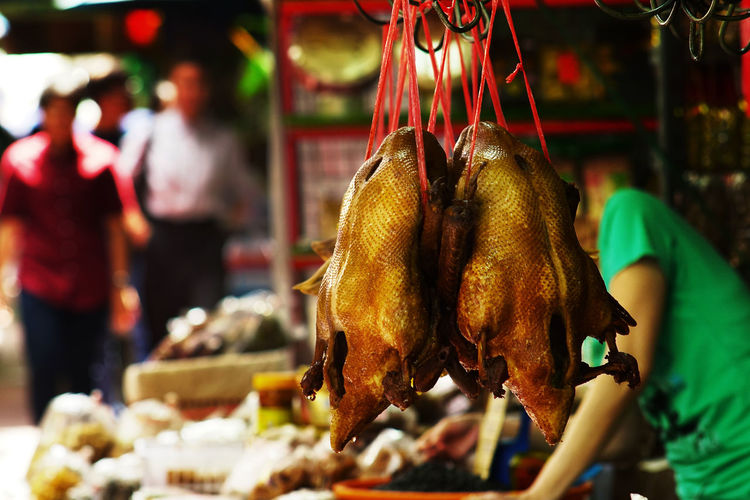 Chinese style Peking roast duck hanging for sale at a sidewalk food stall in China Town China Town Bangkok Chinese Food Cooked Food Food Varieties Roast Duck Asian Food Delicious Food Focus On Foreground Food Food And Drink For Sale Freshness Hanging Incidental People Market Market Stall Meat Peking Duck Retail  Roast Duck Hanging Sidewalk Stall Street Market In Thailand