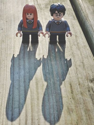 High angle view of children on wooden floor