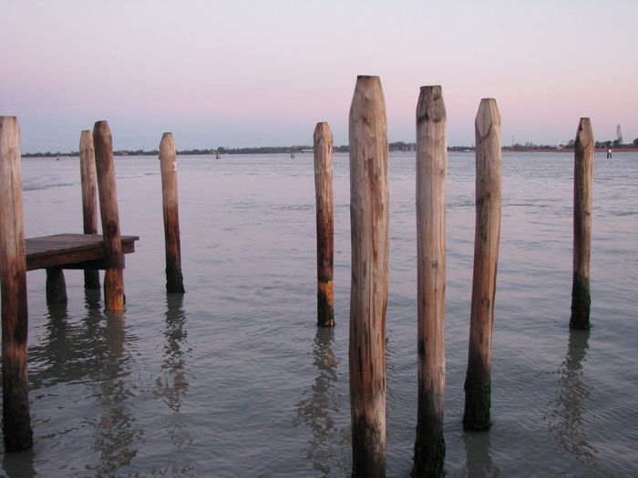 Beauty In Nature Calm Day Idyllic Jetty Nature No People Non-urban Scene Ocean Outdoors Pier Pole Remote Rippled Scenics Sea Sky Tranquil Scene Tranquility Water Wood - Material Wooden Wooden Post