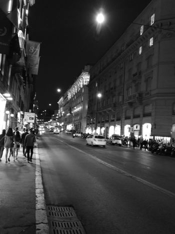 Night Street City Street Illuminated Street Light City City Life Transportation Building Exterior Outdoors Architecture Car Walking Men Adults Only People Blanco Y Negro Blackandwhitephotography LeicaP10 Huawey P10 EyeEm Gallery