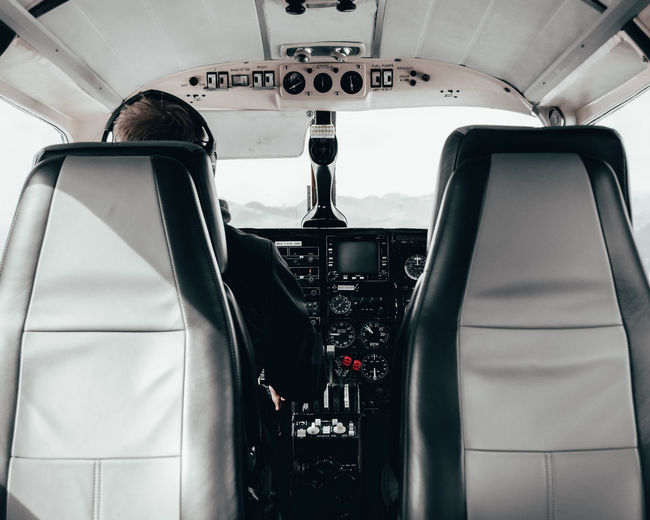 Rear view of pilot flying airplane
