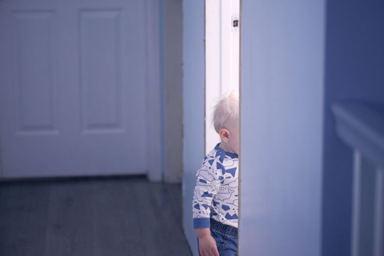 Cute Boy Standing At Entrance Door
