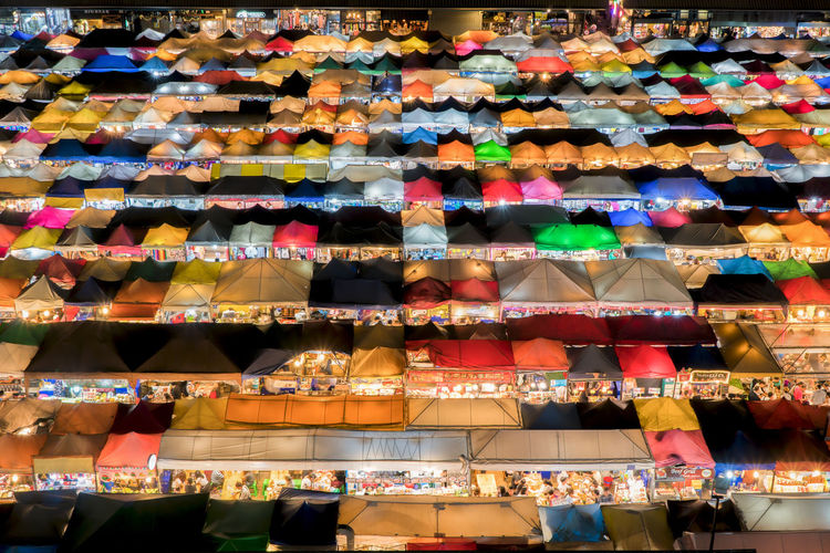 Aerial view of multi colored tents at market