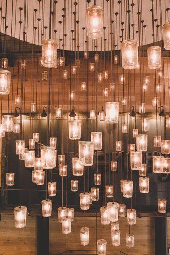 Illuminated electric lights hanging at restaurant