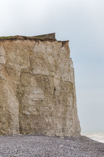 Vertical shot of the cliff face and beach at Seven Sisters cliffs. Beach Chalk Cliff Day England🇬🇧 Nature No People Outdoors Portrait Seven Sisters Cliffs Shingle Sky Sussex Vertical