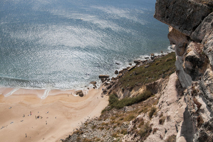 View from above of the beach - Nazaré, Portugal Nazaré  Portugal Sea Water Beach Land Scenics - Nature High Angle View Beauty In Nature Nature Day Motion Aquatic Sport Tranquil Scene Sport Rock Cliff Tranquility Outdoors Surfing Coastline View From Above From Above  Sand Holiday