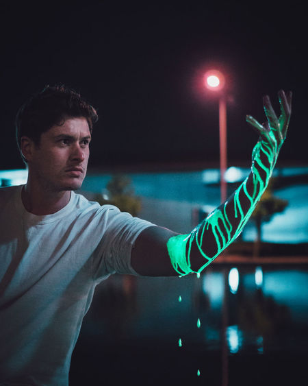 You Drip Illuminated One Person Real People Young Adult Young Men Night Lifestyles Casual Clothing Waist Up Focus On Foreground Light - Natural Phenomenon Lighting Equipment Leisure Activity Indoors  Front View Light Human Arm Standing Nightlife
