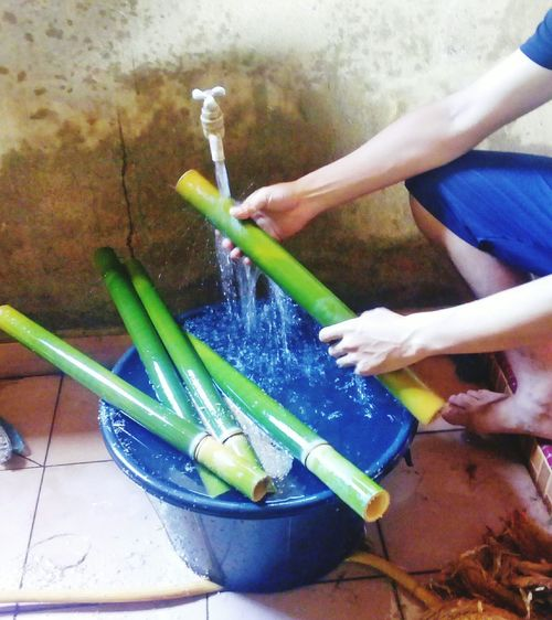 Washing Bamboo Human Hand Human Body Part People One Person Water Lifestyles Spraying Adults Only Only Women Adult Indoors  Day One Woman Only Freshness Close-up bamboo Cook  Cooking rice