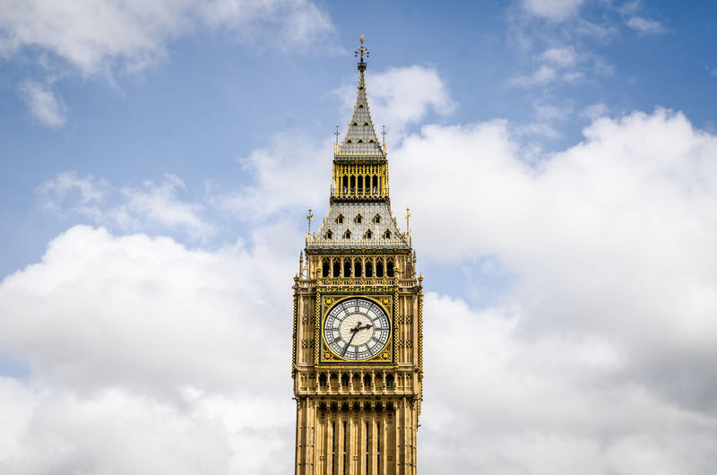 Low angle view of big ben against sky