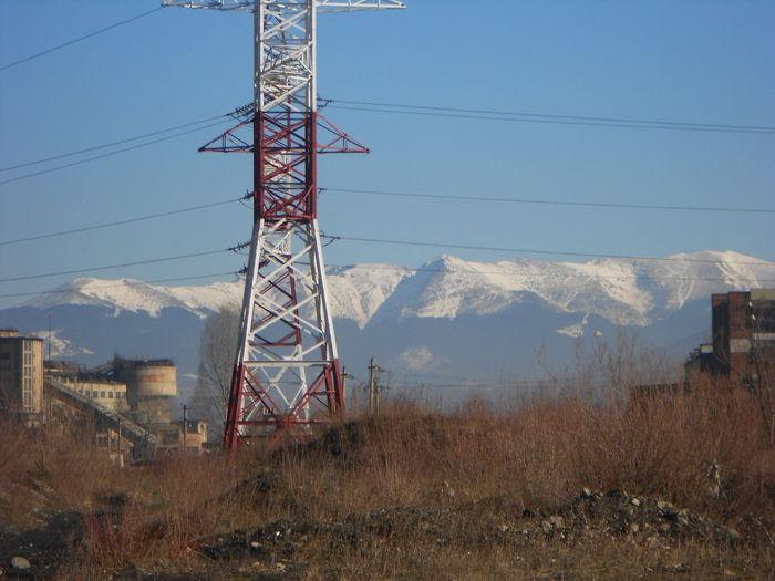Electricity Pylon On Mountain