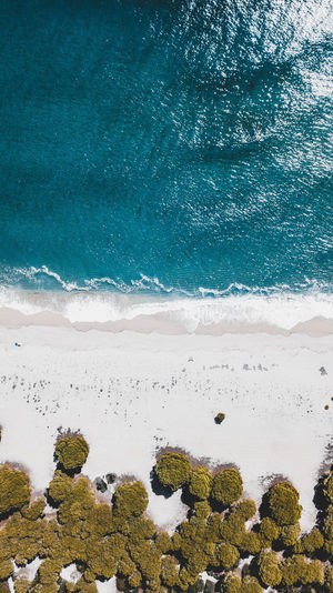 Aerial view of sea during sunny day