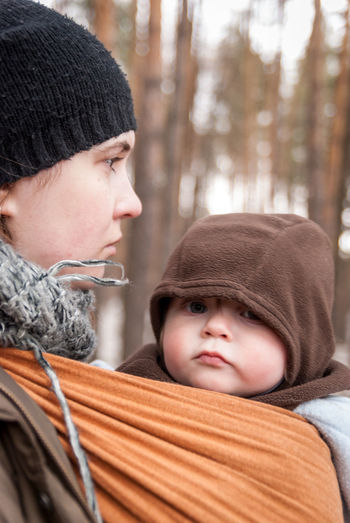 Baby likes the winter when mommy is near Baby Baby Sling Baby Wrap Babywearing Blush Bonding Childhood Children Contemplation Family Head And Shoulders Hood Lifestyle Looking At Camera Love Maternity Mom Mother And Son Motherhood Outdoors Parenting Serious Sling Winter Woman