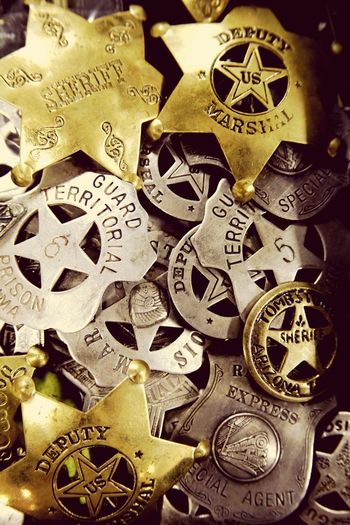American historic law enforcement badges Law Law Enforcement Badge American History Marshal Deputy Sheriff No People Coin Backgrounds Indoors  Large Group Of Objects Close-up