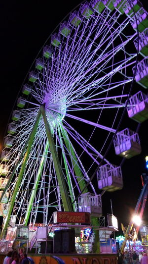 Amusement Park Ride Architectural Feature Architecture Arts Culture And Entertainment Blue Built Structure City Glowing Illuminated Lighting Equipment Low Angle View Modern Multi Colored Night No People Outdoors Sky