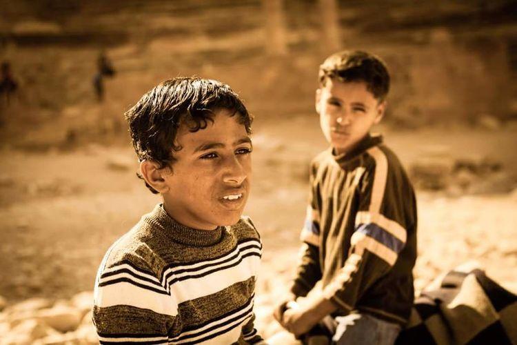 A couple of local Jordanian boys hangout amid the crumbling beauty of the hidden city of Petra, Jordan Petra Boys Males  Childhood Day Bonding Portrait The Portraitist - 2017 EyeEm Awards City Streetphotography Architecture History