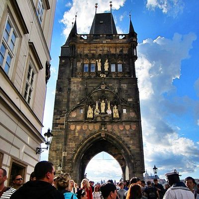 Queuing to cross over Charles Bridge in Prague. The weather was crazy on that day. Within a couple of hours, it rained several times. Fortunately sun rose warmly afterwards. Prague, Czech Republic August 2014
