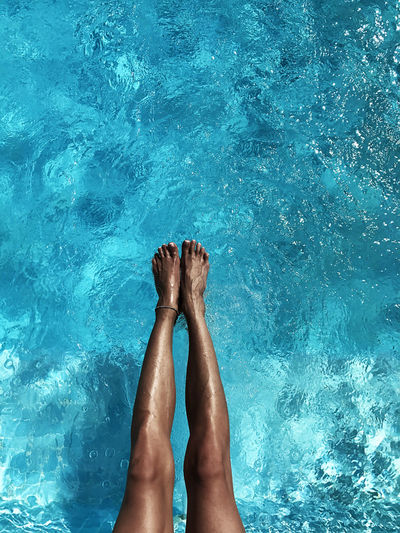 Low section of woman in swimming pool
