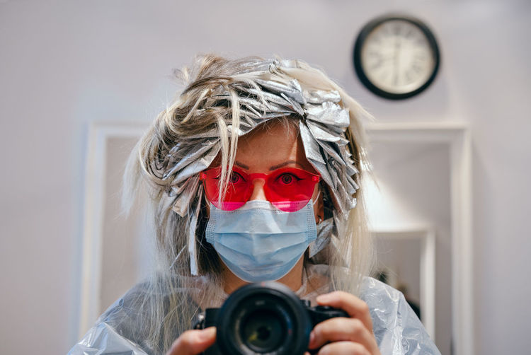Portrait of woman at beauty salon photographing