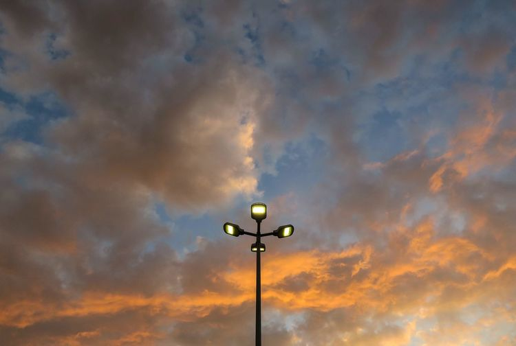 Cloud - Sky Sky Low Angle View Sunset Lighting Equipment Street The Photojournalist - 2018 EyeEm Awards Orange Color Beauty In Nature Outdoors Illuminated Electricity  Silhouette Street Light No People Dramatic Sky Nature Light Pole Floodlight Technology