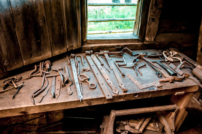 Farrier tools in ancient smithy Ancient Blacksmith  Rustic Wood Workplace Blacksmith Tools Blacksmithing Craftsmanship  Farrier Forget Hammer Handwork Handworking Indoors  Interior Manufacture No People Rasp Smithy Smithy Detail Smithy Tool Supplies Tools Wooden Workroom