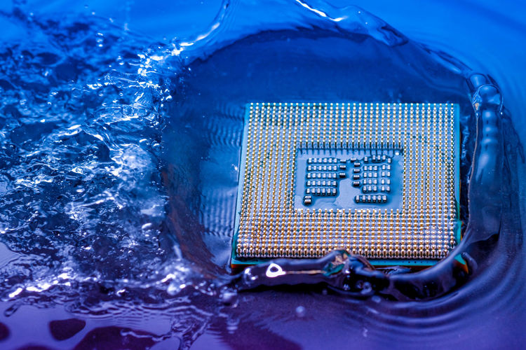 Close-up of computer chip in water