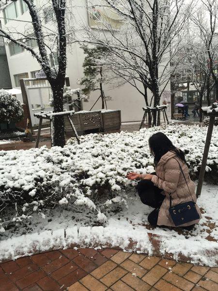 City Lifestyles One Person Outdoors Sidewalk Sitting Snow Warm Clothing Winter The Week On EyeEm