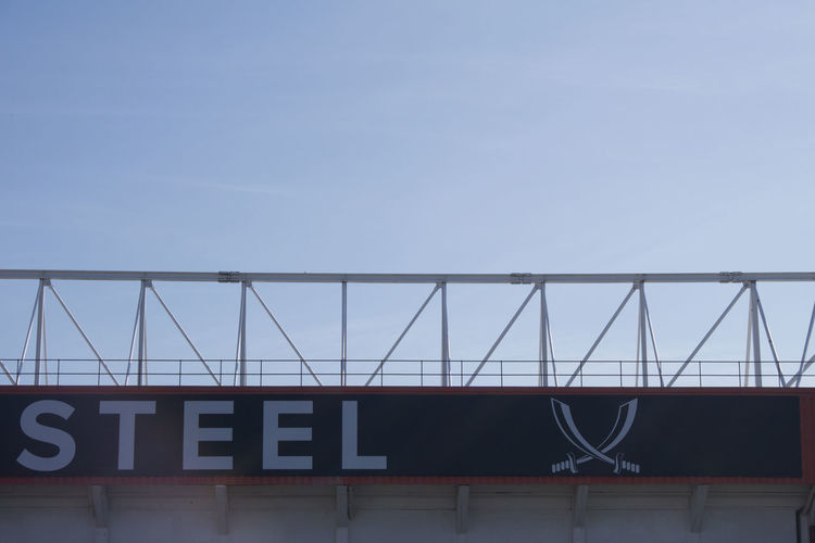 Partial shot of 'Forged in Steel' and logo at Bramall Lane Football Ground, Sheffield United. Sheffield Sheffield United Bramall Lane Football Stadium Ground Standing Yorkshire Blades Sky Architecture Built Structure Text No People Western Script Copy Space Day Clear Sky Outdoors Low Angle View Sign Building Exterior Capital Letter Metal