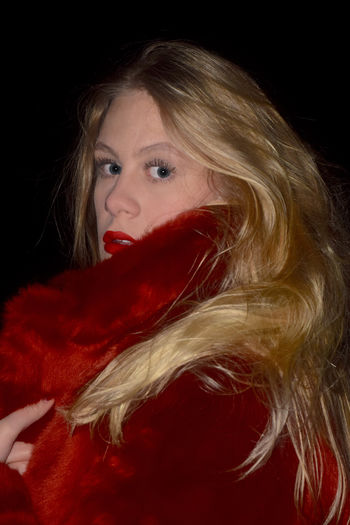 Lady in red Blue Eyes Side Profile Beautiful People Beautiful Woman Beauty Black Background Blond Hair Close-up Coat Cold Headshot Human Lips Long Hair Looking At Camera One Person One Woman Only One Young Woman Only People Portrait Red Red Lips Red Lipstick Side Portrait Studio Shot