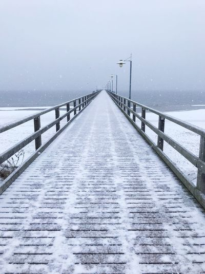 Snowy Bridge to Infinty P. Water Germany Maritime Mecklenburg-Vorpommern Baltic Sea Germany Deutschland Symmetrical Seebrücke Snow Cold Temperature Winter The Way Forward Direction Nature Water Scenics - Nature Railing Diminishing Perspective No People Pier Outdoors Sky Environment