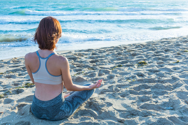 Yoga Yoga Pose Yogagirl Yoga ॐ Yoga Practice Leisure Activity Lifestyles Water One Person Sea Real People Rear View Land Women Beach Sitting Beauty In Nature Nature Adult Relaxation Wave Sport Sunlight Hairstyle Outdoors