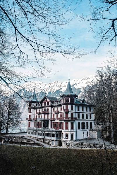 Magnificence in the clearing Switzerland Giessbachfall Giessbach Architecture Building Exterior Bare Tree Built Structure Tree No People Day Outdoors Nature Sky The Traveler - 2018 EyeEm Awards