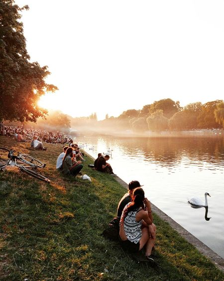 Leisure Activity Lake Lifestyles Tree Casual Clothing Sunset Vacations Forest Water Clear Sky Innocence Person Tranquil Scene Full Length Lakeshore Enjoyment Beauty In Nature Non-urban Scene Capture Berlin The City Light Discover Berlin