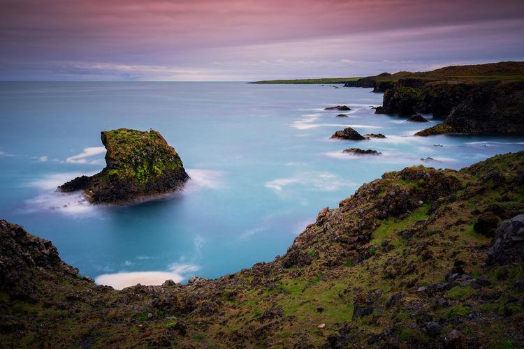Long exposure Cliffs and basalt rocks in Arnarstapi, Snaefellsnes peninsula in Iceland. Arnastapi Beauty In Nature Horizon Over Water Long Exposure Peninsula Rock Rock Formation Scenics - Nature Sea Sky Tranquil Scene Water