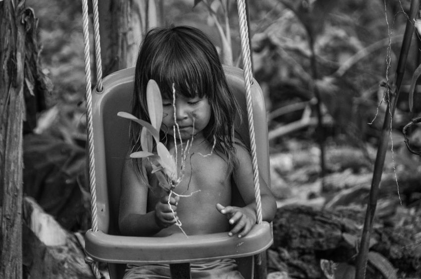 Curumim se diverte brincando com a natureza Aldeia Guarani Guarani Village Indian Indian Culture  Indian Reservation Indigenous Child Nature Rio Silveira Indian Reservation Travel Photography Black And White Childhood Criança Indígena Curumim Day Girl Guarani Indian Indio Guarani One Person Outdoor People Playing Praia De Boraceia Pretoebranco Real People Reserva Indigena Rio Silveira
