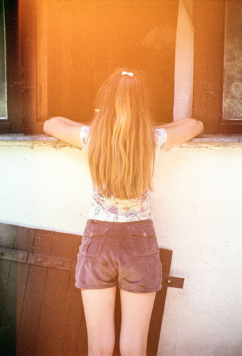 Let me see Analogue Photography Film Standing Back Portrait Cottage Curious Cute Exposed Girl Window
