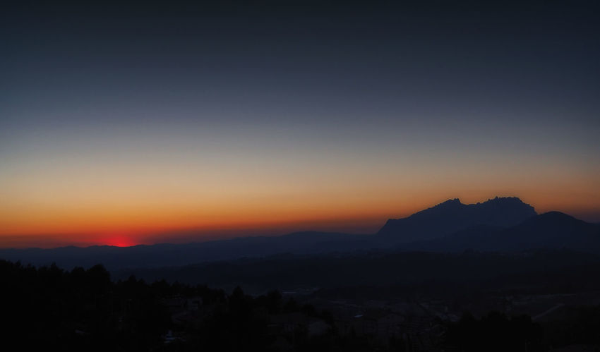 Sunset in Ullastrell Beauty In Nature Landscape Mountain Mountain Range Nature No People Outdoors Range Scenics Silhouette Sky Sunset Tranquil Scene Tranquility Tree