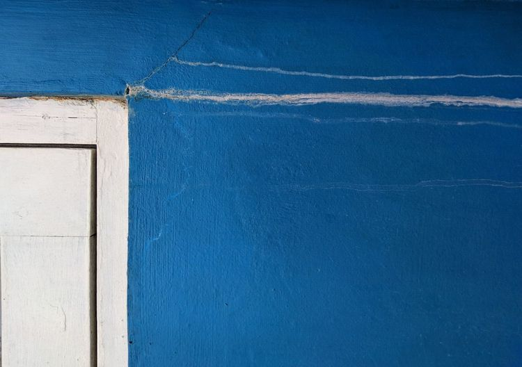 Close-up of blue wall against building