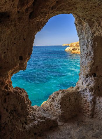 Aboneca window Carvoeira Lagoa Window View Window Window View Aboneca Arch Solid Tranquil Scene Rock Formation Beauty In Nature Scenics - Nature No People Tranquility Horizon Over Water Cave Natural Arch Nature Outdoors