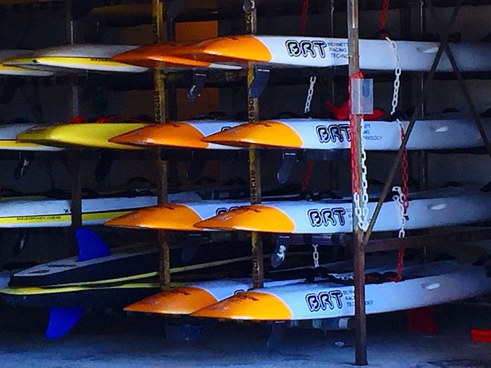 Sea Kayak Storage Sea Kayak Kayak Ski Ocean Water Sports Boat Kayak Storage Racks Orange Kayaks In Racks Kayaking Water Safety Surf Life Surf Life Saving Lifeguard Kayak Water Recreation Sport Beach Recreation