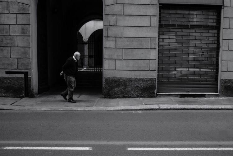 Parma Old Man Building Exterior Architecture Built Structure Real People Full Length One Person Day Street Walking Men City Leisure Activity Road Entrance Building Outdoors Lifestyles Side View Arch Adventures In The City Focus On The Story The Street Photographer - 2018 EyeEm Awards