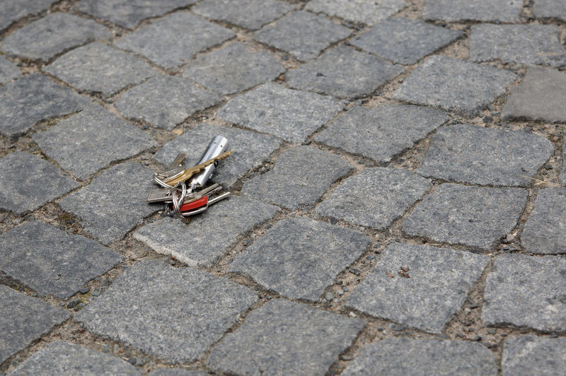 Copy Space Finding Keys Losing Lost Cobblestone Found Ground Keyring Lost Keys No People Outdoors Pavement Set Of Keys Street