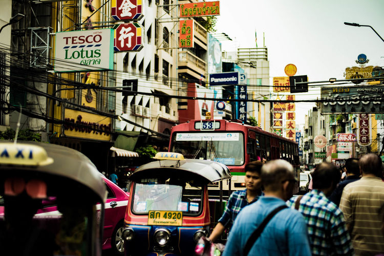 Took this picture in china town in Thailand. a bit out of focus but the picture feels good that i can't delete. Sony A7ii + contax carlziess 50mm f1.7 Bus Capital Cities  City City Life City Street Day Group Of People Lifestyles Old Lens Outdoors SONY A7ii Thailand Travel Destinations