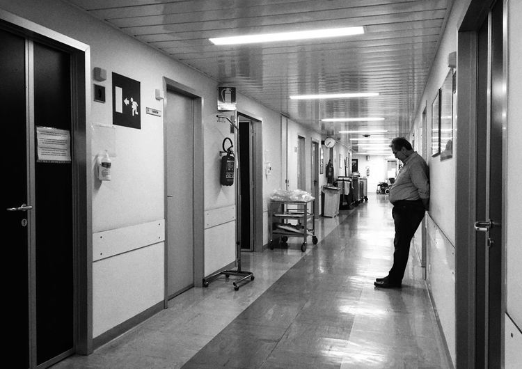 Hospital Shadows & Lights Street Photography Black & White Black And White Blackandwhite Mobilephotography Mobile Photography Architecture Arcade Building Corridor Indoors  Real People Built Structure Lifestyles One Person