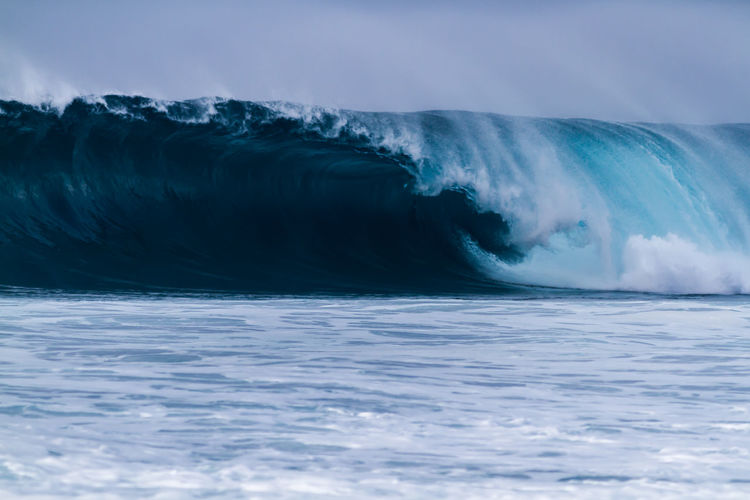 A Giant wave on the north shore of Oahu Hawaii Breaking Extreme Giant Hawaii Nature Oahu Surf Travel Beach Beauty In Nature Blue Crashing Landscape Motion Nature No People North Shore Ocean Outdoors Power In Nature Scenics Sea Surfing Water Wave